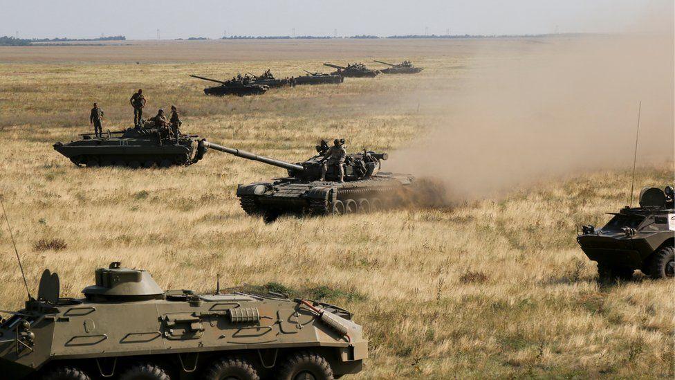 Ukrainian tanks and APCs move towards the de-facto border with Crimea near Kherson, southern Ukraine, Friday, Aug. 12, 2016