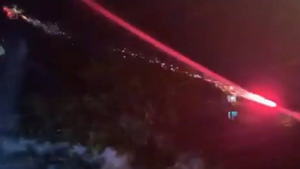 A drone in the air apparently shooting a firework