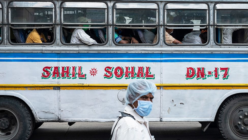A scene from a crowded bus as West Bengal government has restricted the bus services by 50% to curb the spread of COVID-19 in Bengal, in Kolkata, India - 6 May 2021