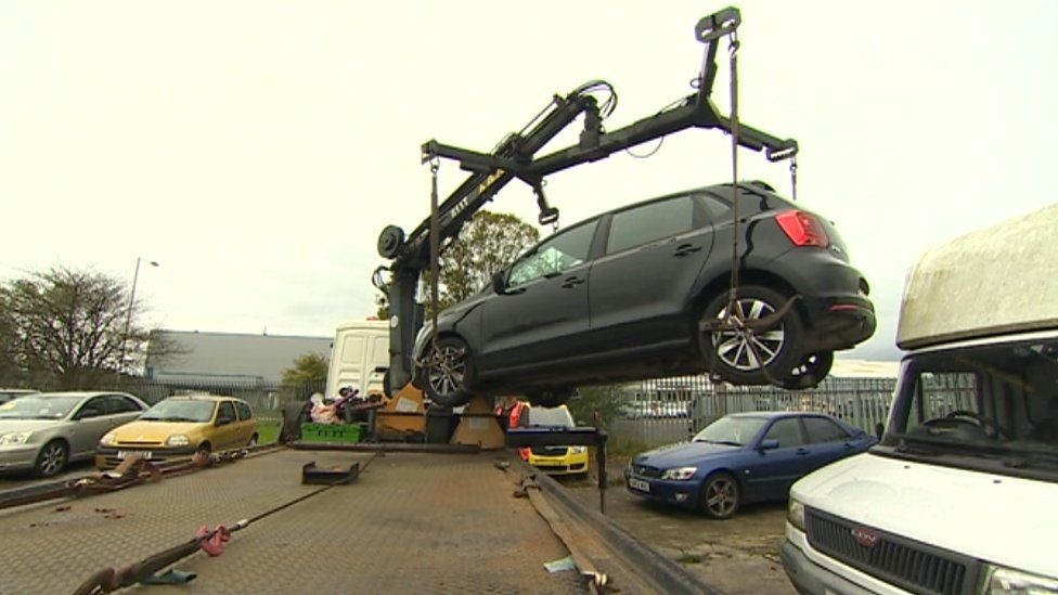 Car being impounded by DVLA in Cardiff