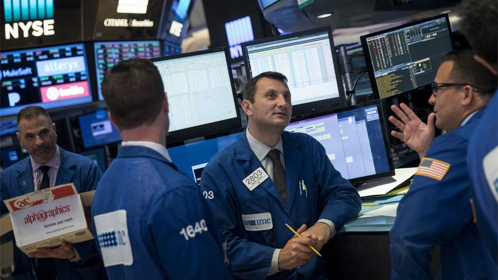 Traders work after news reports emerged about the Federal Reserve's decision to raise interest rates on the floor of the New York Stock Exchange (NYSE) June 14, 2017 in New York