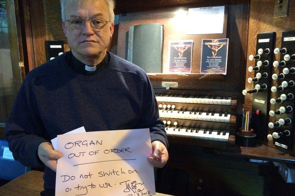 Canon Ian Black and damaged church organ
