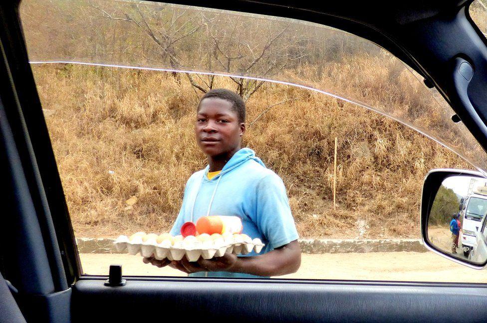 Man selling eggs by the roadside