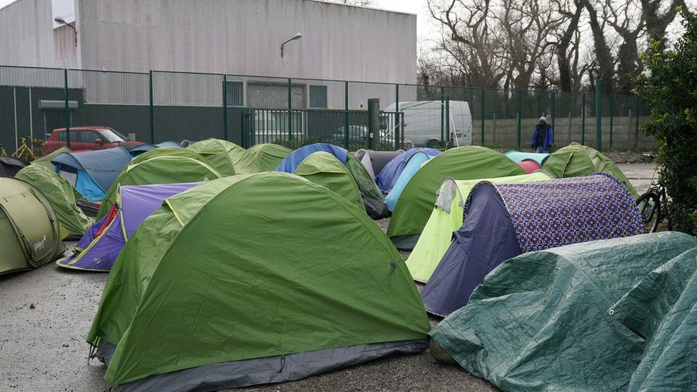 Migrants camp on an industrial estate near the Calais Ferry terminal on January 31, 2020 in Calais, France