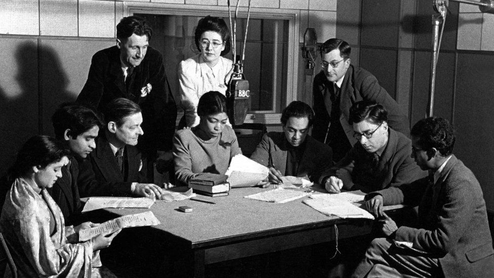 Una Marson amongst colleagues including T.S. Eliot and George Orwell looking over her shoulder