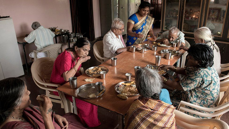 Several of home's residents eating a meal at the care home