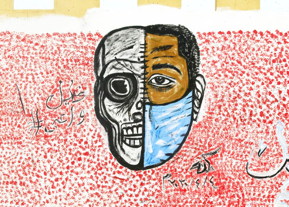 Graffiti on a wall showing a half skull, half face in a mask in Khartoum, Sudan - Wednesday 8 April 2020