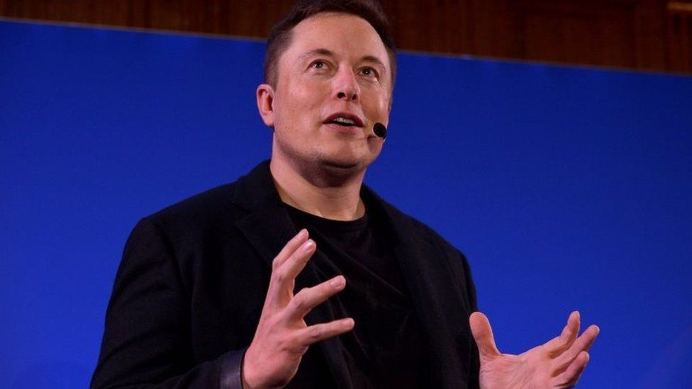 (FILES) This file photo taken on December 2, 2015 shows Elon Musk, CEO of US automotive and energy storage company Tesla, presents his outlook on climate change at the Paris-Sorbonne University in Paris.