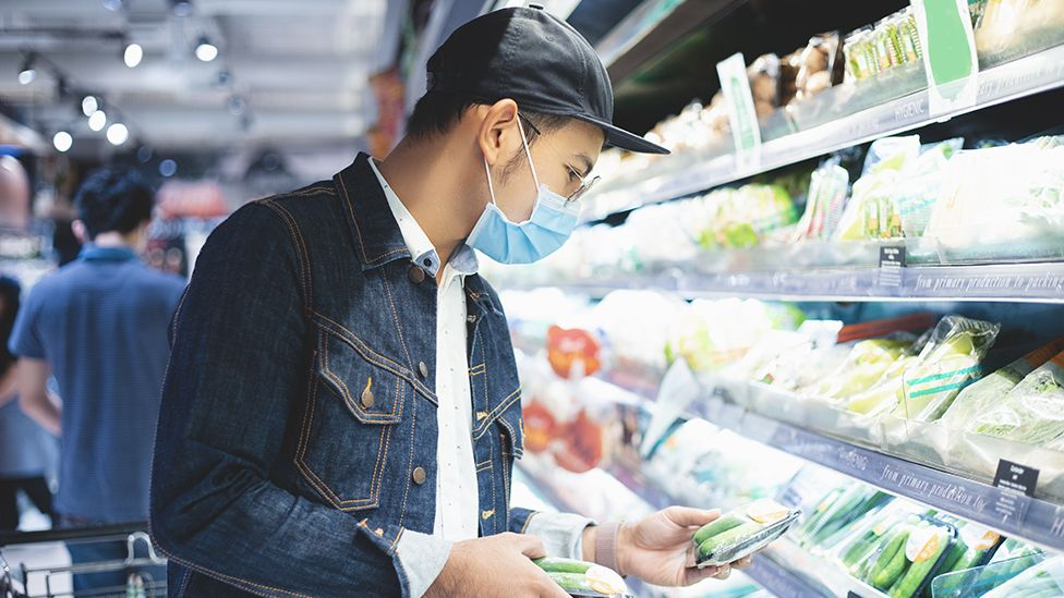 Man shopping with mask on