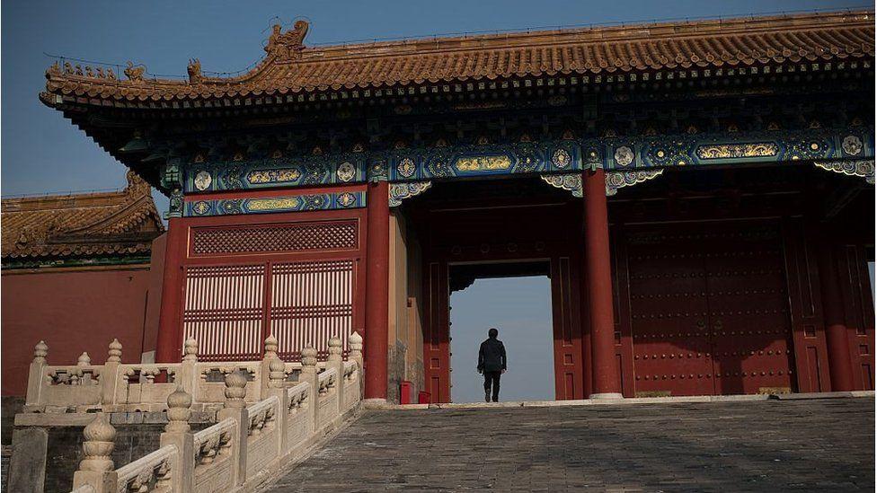 A man walks through a gate inside the Forbidden City in Beijing on 29 September 2016.