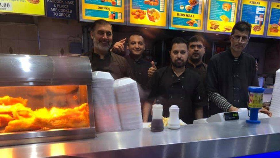 Staff behind the counter at Victoria Fish Bar