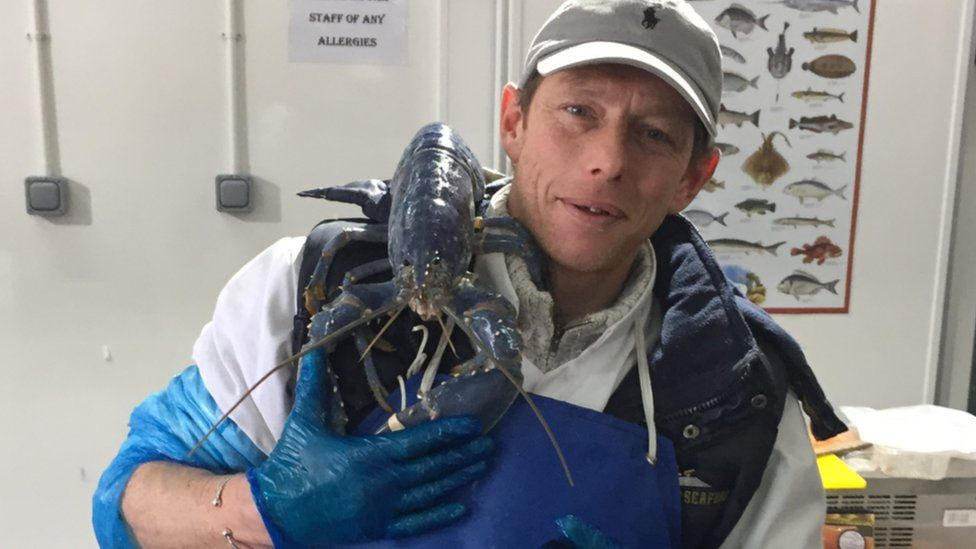 Tony McLean with the blue lobster on his shoulder