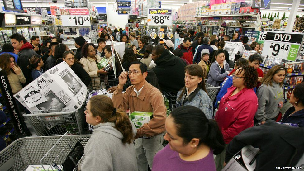 Shoppers queuing in the US