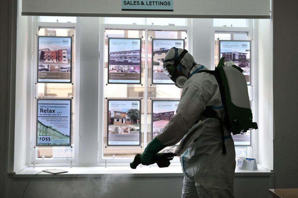 Estate agent's office being cleaned