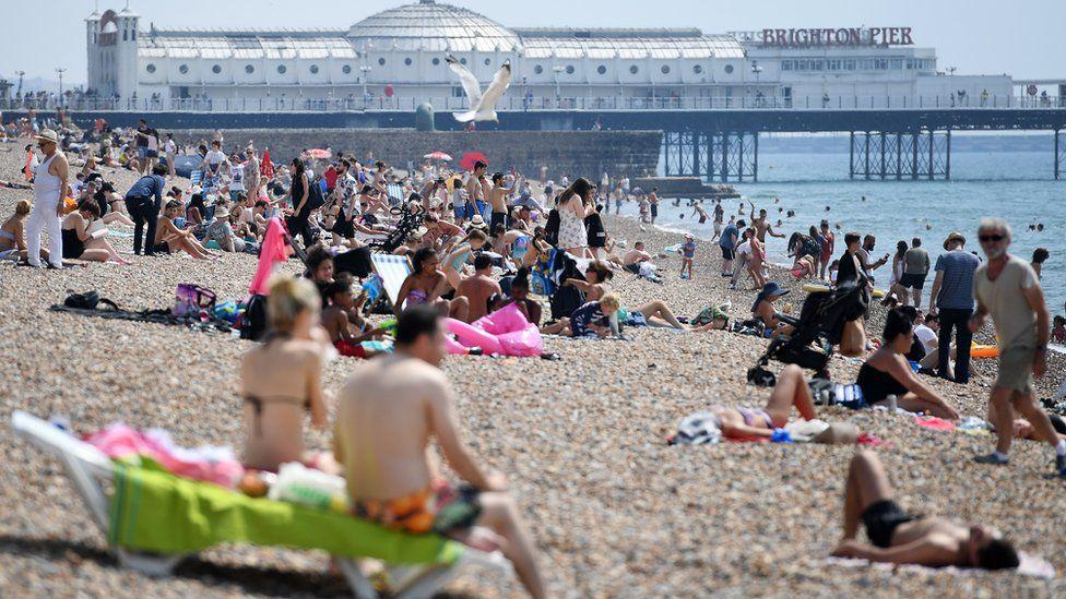 People on beach in Brighton