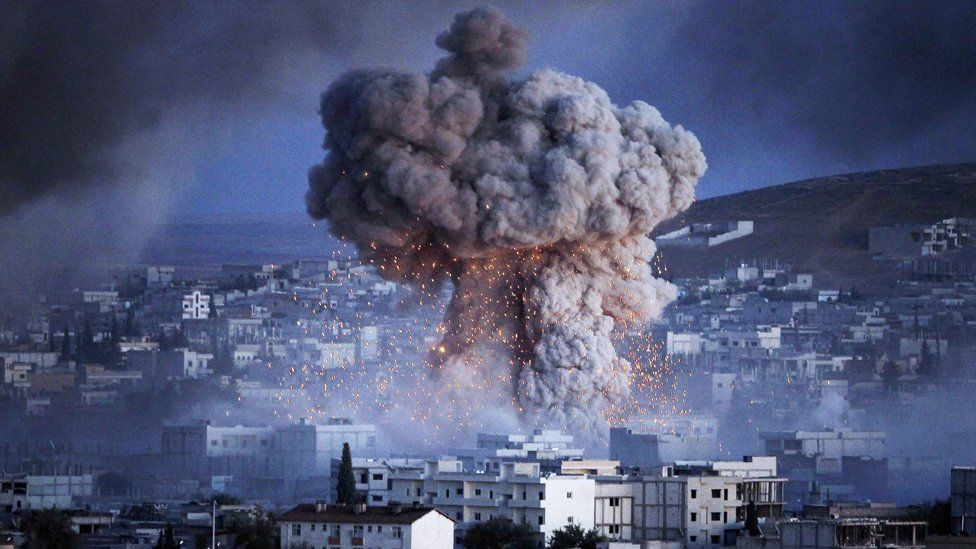 An explosion rocks Syrian city of Kobani during a reported suicide car bomb attack by the militants of Islamic State