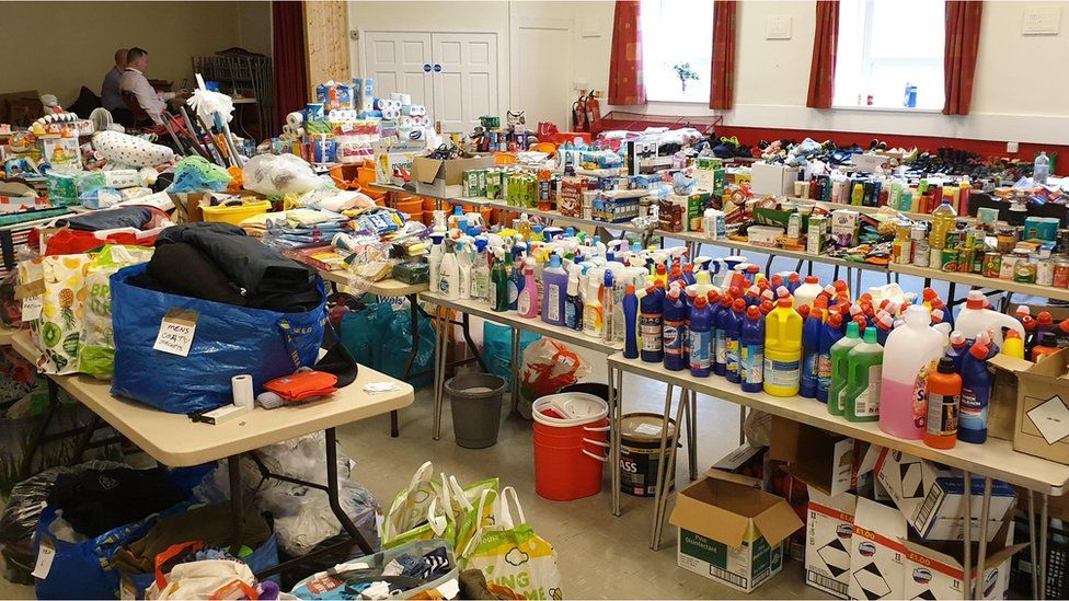 donations at Trallwn Community Centre in Pontypridd for flood victims