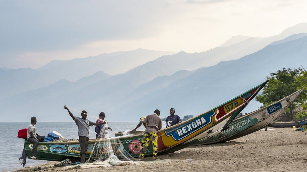 Fishermen on the shores of Lake Edward in the Democratic Republic of Congo