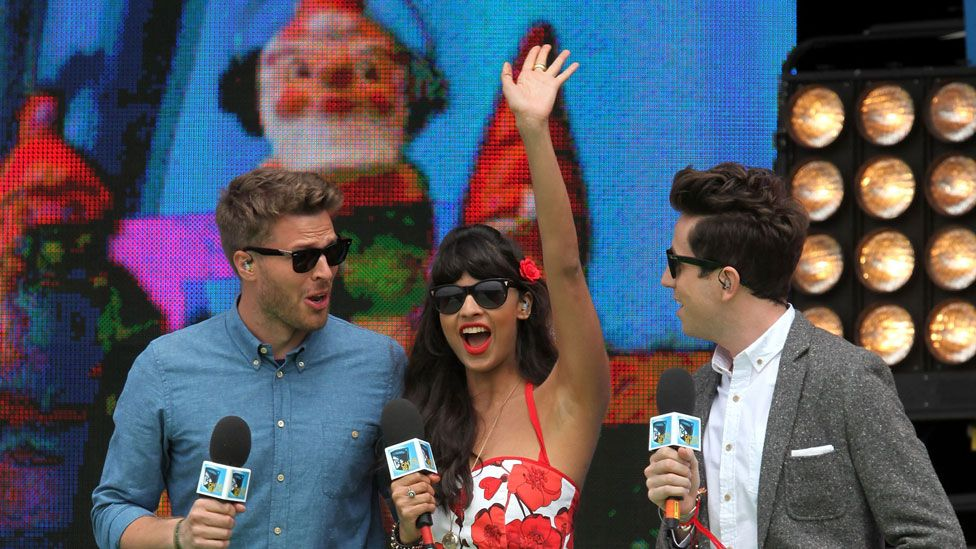 Jameela Jamil with Rick Edwards (left) and Nick Grimshaw (right)