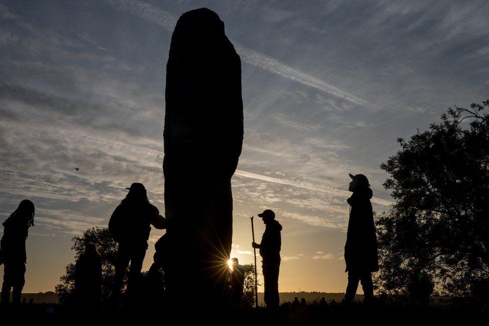 Silhouetted Avebury stone