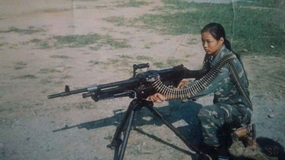 Mira as a soldier with a gun