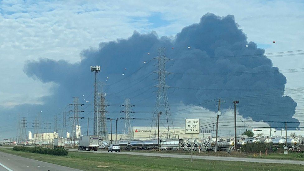 A plume of smoke is seen above the chemical plant