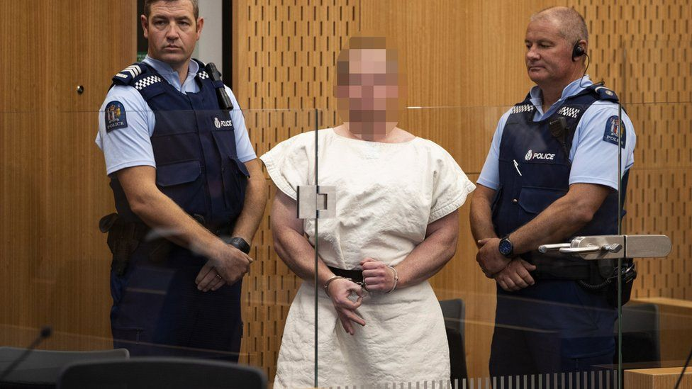 Brenton Tarrant (Pixelated) makes a sign to the camera during his appearance, on a charge of murder for Christchurch mosque massacre in the District Court, Christchurch, New Zealand, 16 March 2019, reissued 05 April 2019