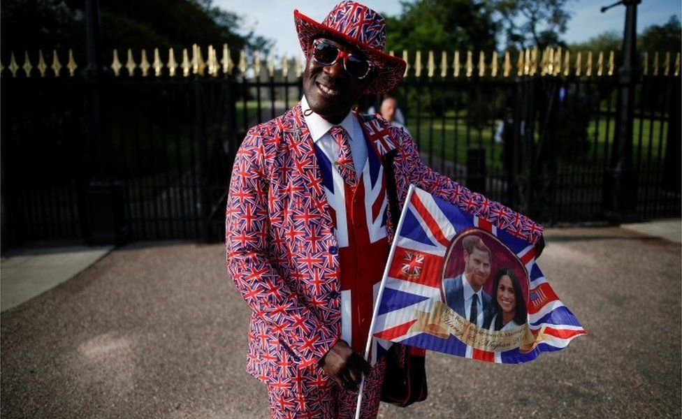 """Joseph Afrane, from Ghana, poses for a photograph after arriving in Windsor, Britain, May 17, 2018. """"I""""m here for the big day, to congratulate them. They support the Commonwealth,"""" said Joseph."""