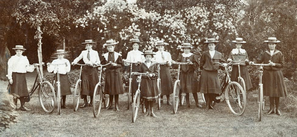 A group of women and girls with bikes, circa 1900