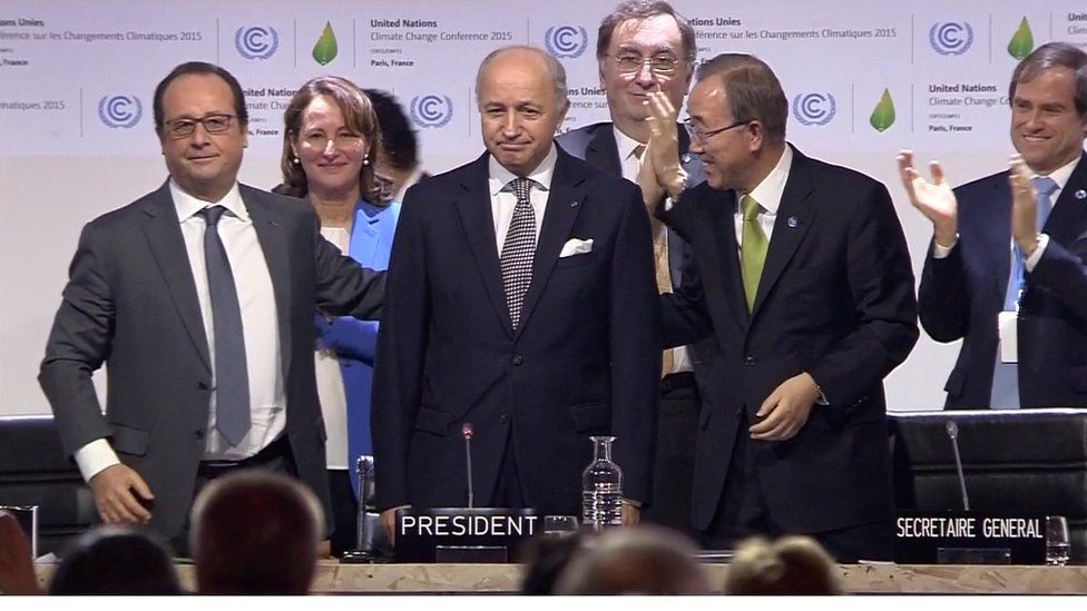 """The French president (left) called on nations to adopt """"the first universal agreement on climate""""."""