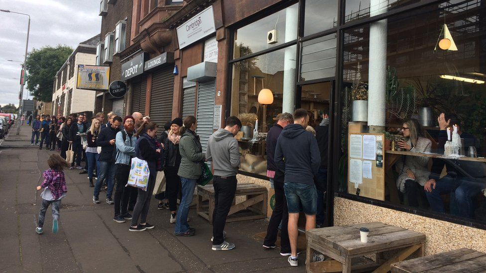 Queue of people outside the bakery