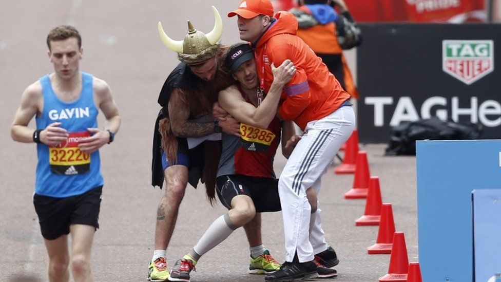 A runner collapsing before the London Marathon finish line