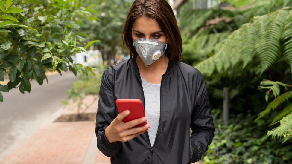 Woman in mask on app