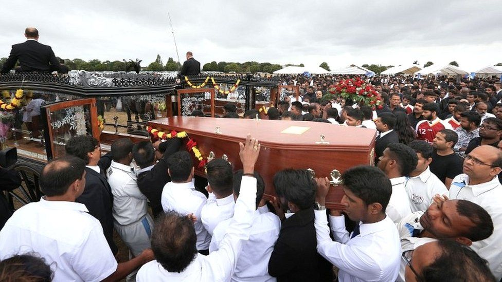 The coffins of Kenugen Saththiyanathan and his brother Kobikanthan Saththiyanathan are loaded on to horse drawn carriages