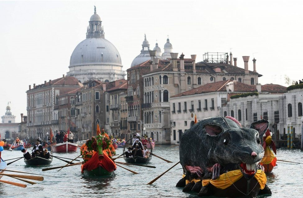"The ""Pantegana"" (Big Rat) sails on the Grand Canal with other decorated boats for the traditional regatta which officially opens the Carnival in Venice"