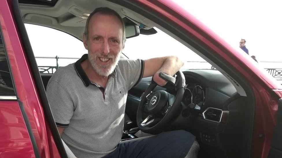 Mr Davies in his car