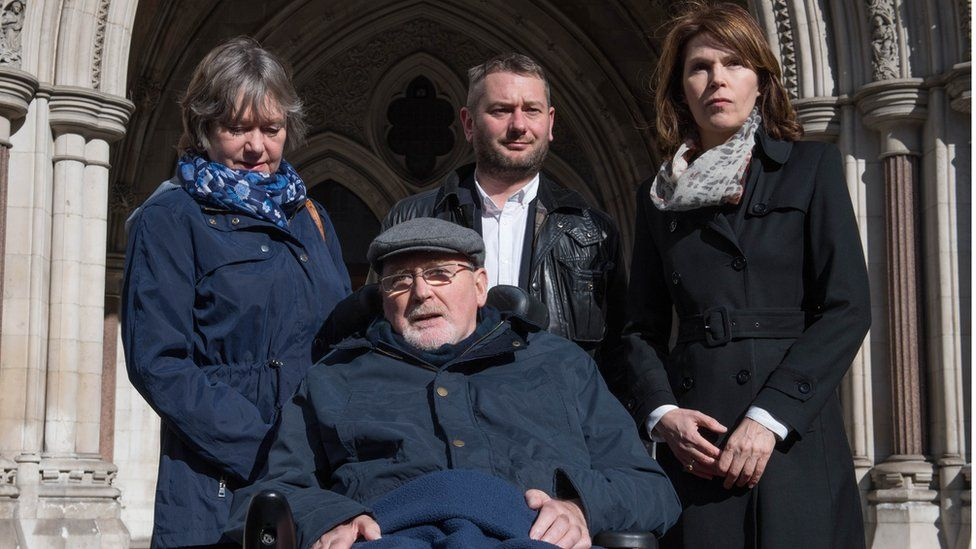 Noel Conway outside The Royal Courts of Justice with his family in 2017