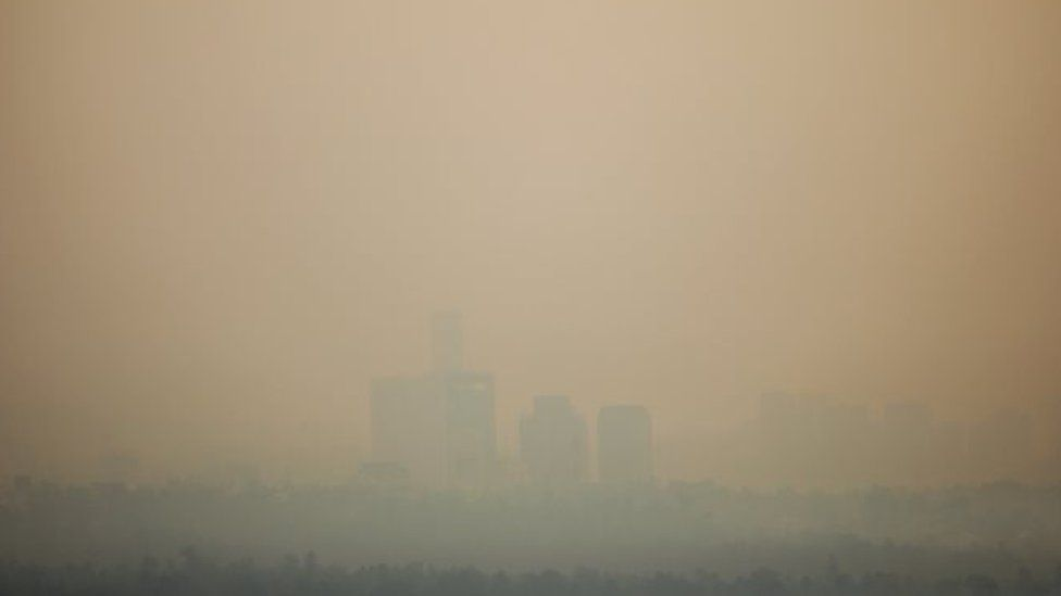 Buildings are seen through the air pollution during a day where Mexico City's authorities have activated a contingency plan due to bad air conditions on May 14, 2019 in Mexico City