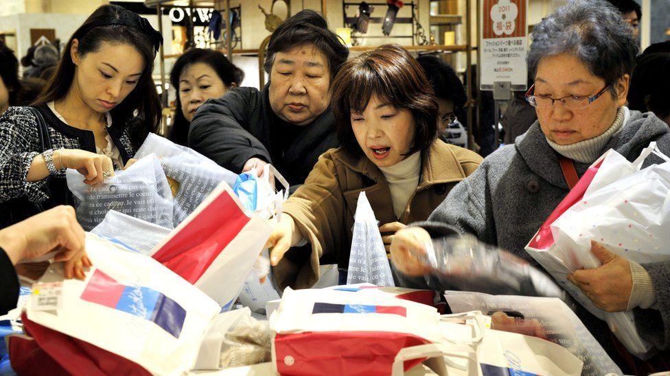 New Year's shoppers pick up the lucky bags