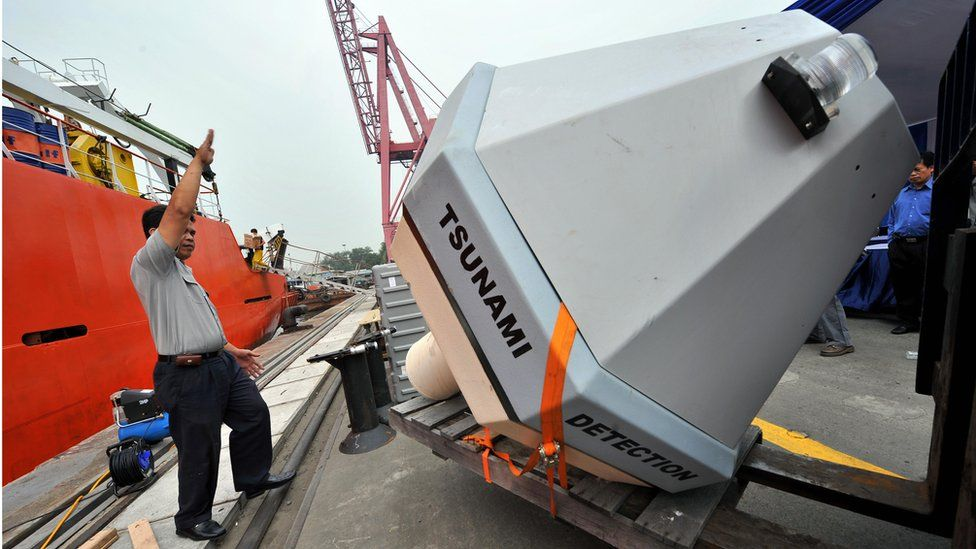 Workers unload a Tsunami Buoy, a device to detect early tsunami warnings, donated by the US National Oceanographic and Atmospheric Administration (NOAA) in Jakarta on June 10, 2008