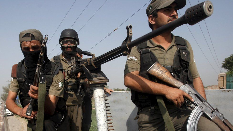 Pakistani soldiers near an air force base in Peshawar 18 September 2015