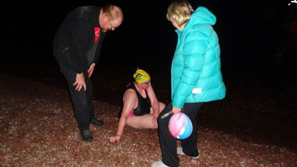 Helen Beveridge emerging from water