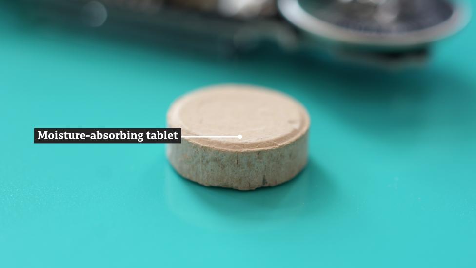 A moisture-absorbing block