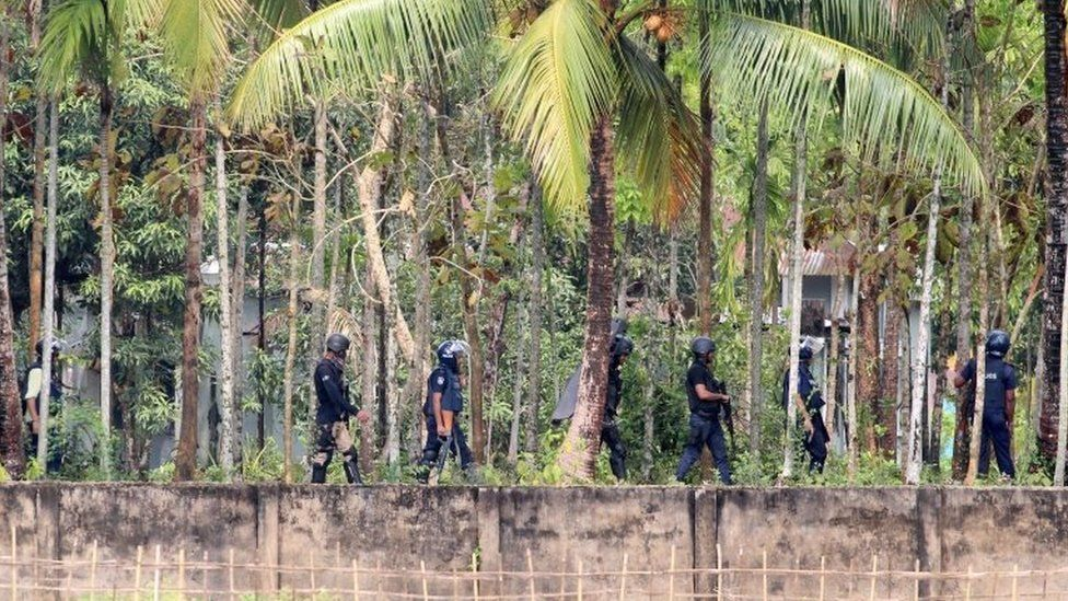 Security personnel get ready for raid in Nasirpur village, Moulvibazar, northeast of the capital Dhaka, Bangladesh, March 30, 2017.