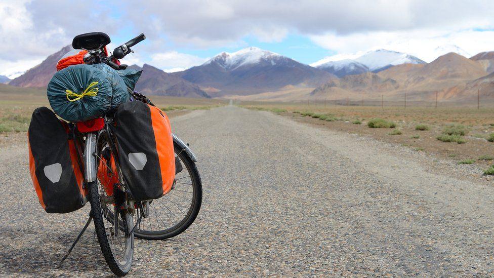 Long distance cycling on M41 Pamir Highway, Pamir Mountain Range, Tajikistan. File image
