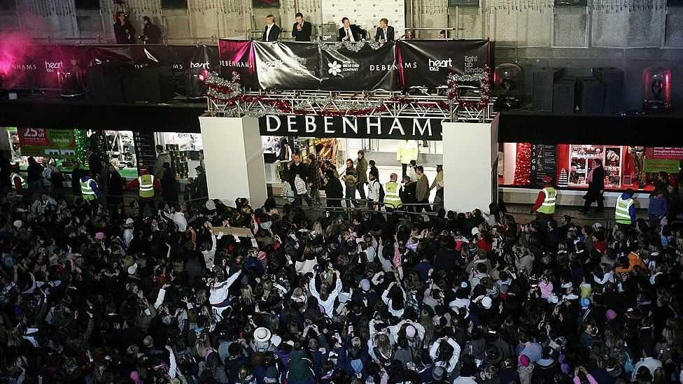 Westlife switched on Oxford Street's Christmas lights from Debenhams in 2005