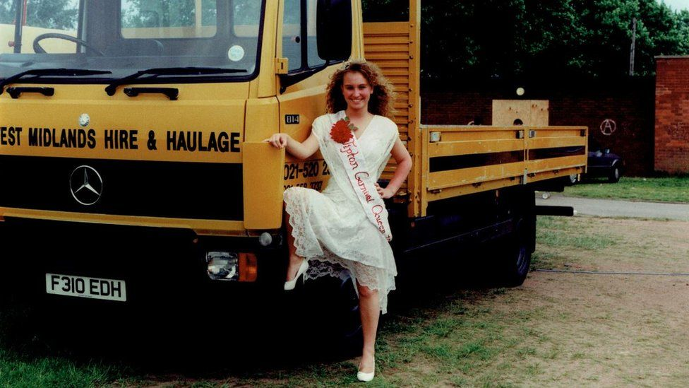 Tipton Carnival Queen posing next to haulage truck