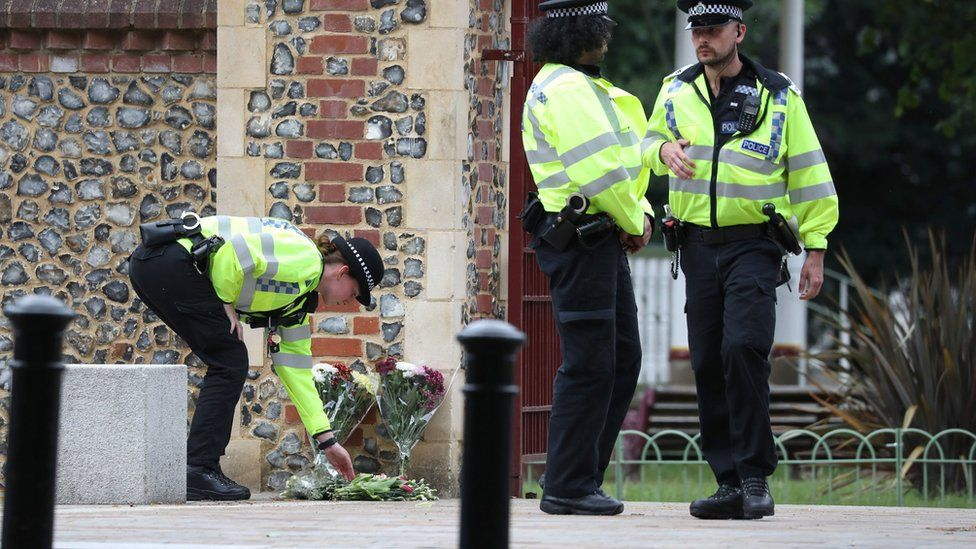 Police move flowers from Abbey Gate closer to the entrance at Forbury Garden