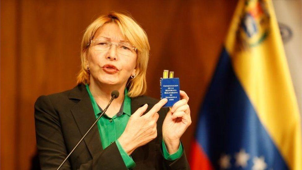 Venezuela's chief prosecutor Luisa Ortega Diaz holds a Venezuelan constitution during a news conference in Caracas, Venezuela, July 25, 201
