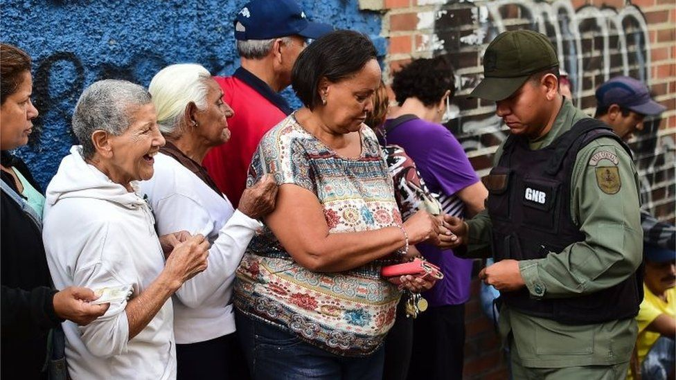 People queue to buy basic food and household items outside a supermarket in the poor neighbourhood of Lidice, in Caracas, Venezuela, on May 31, 2016.